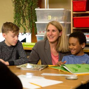 Julia Brim-Edwards in classroom with children